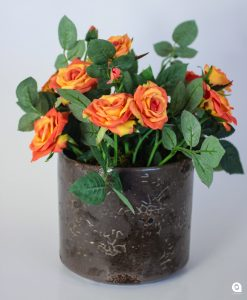Orange mini diamond roses in small round brown ceramic vase - 20cm