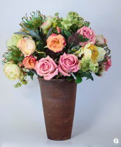 Indigenous + roses  in brown vase - 45cm