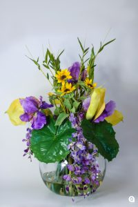 Purple wisteria + yellow lillies in round fish bowl glass vase - 60cm